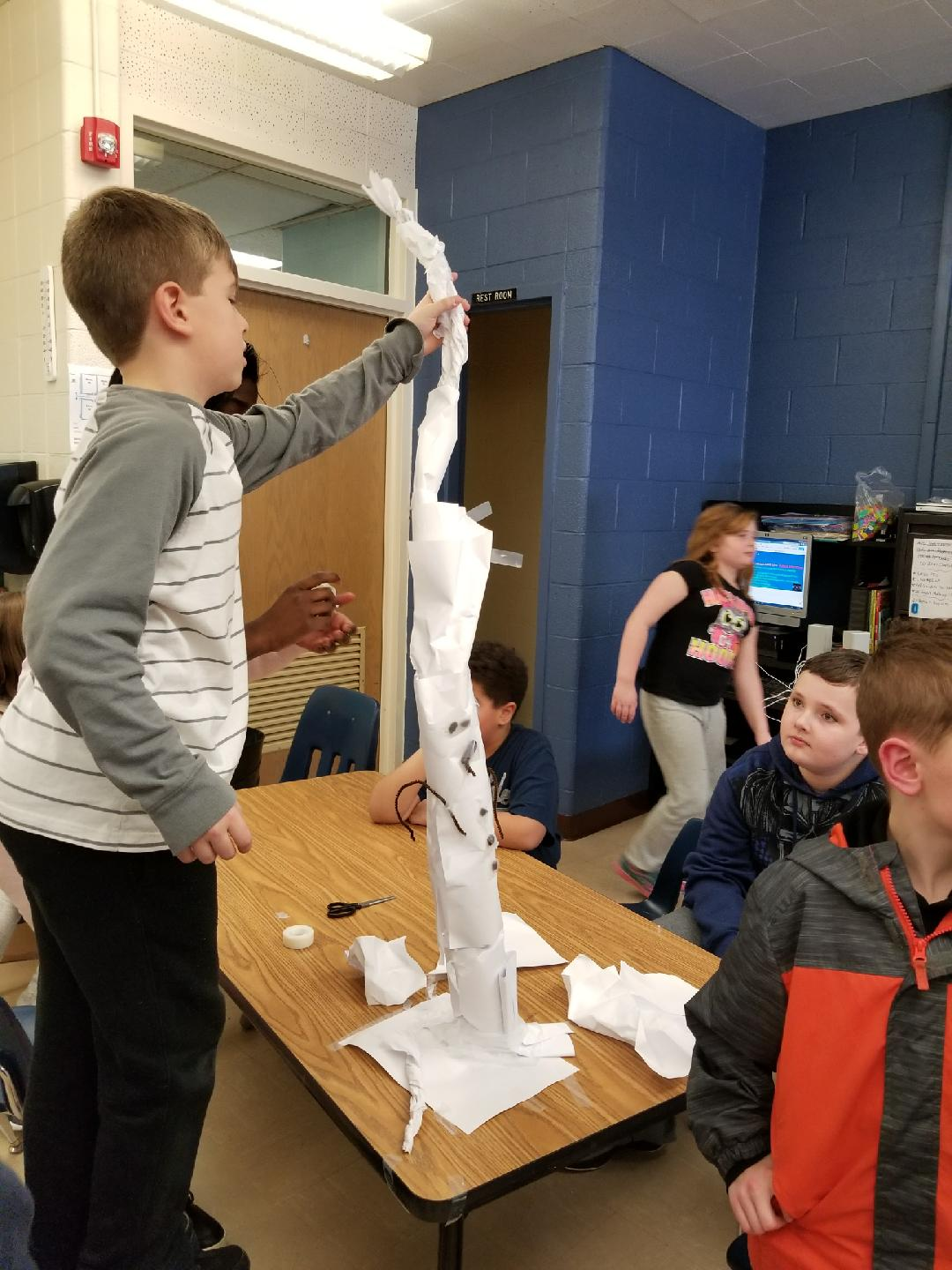Fifth  graders in STEM Studio doing the snowman challenge